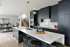 Sleek Black Kitchen for this Family of Five
